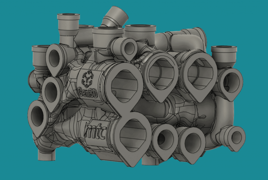 Extra stock material is added to the larger ports to allow for post-machining of the manifold to the correct tolerances