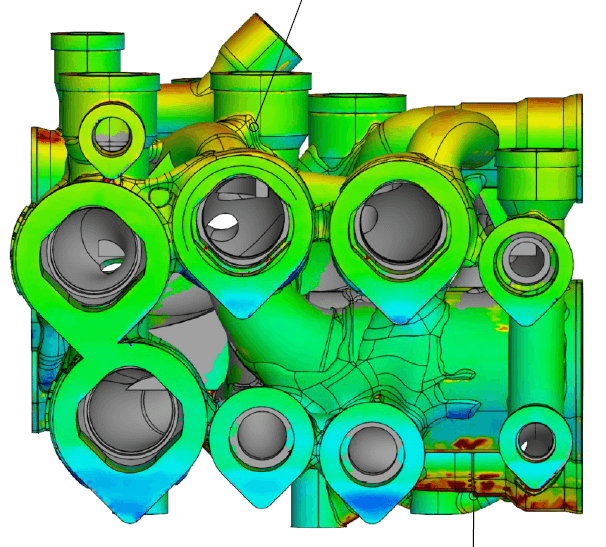 Fringe-projection scan of manifold overlaid on the CAD model